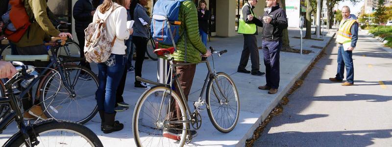 Students discussing impact of bike lane